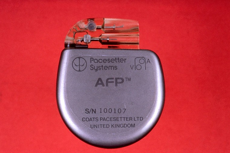 "A rounded silver object with clear plastic section at the top. On the silver part it reads, ""Pacesetter Systems, AFP. S/N 100107, Coats Pacesetter Ltd, United Kingdom."""